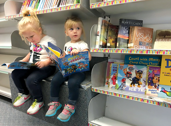 Young patrons perch inside the Twinsburg (OH) Public Library vehicle, purchased second hand