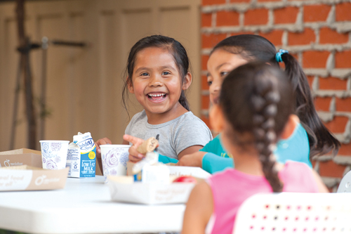 Kids enjoy a Lunch at the Library meal. San Mateo County Library photography by Becky Ruppel
