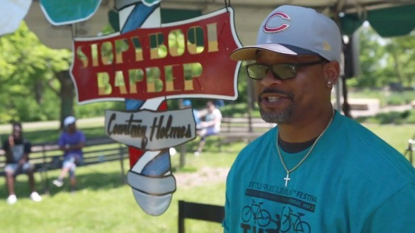"The ""Storybook Barber,"" Courtney Holmes, at the Little Free LIbrary Festival."