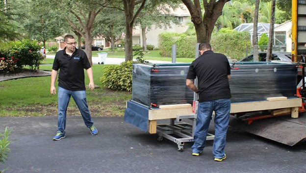 Unloading a large Reef Savvy aquarium from truck