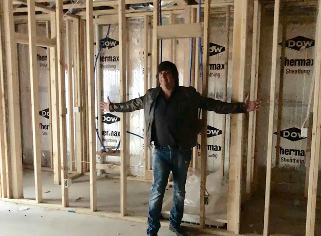 Ryan standing in front of the future BRS360 location in his basement