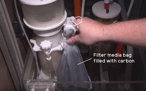 Carbon filter media bag in sump