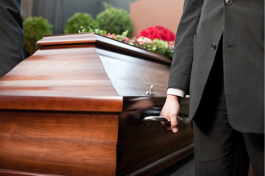 Funeral home director at a service in Edison Park, Chicago