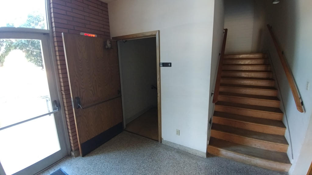 STAIRS TO DOWNSTAIRS RESTROOMS