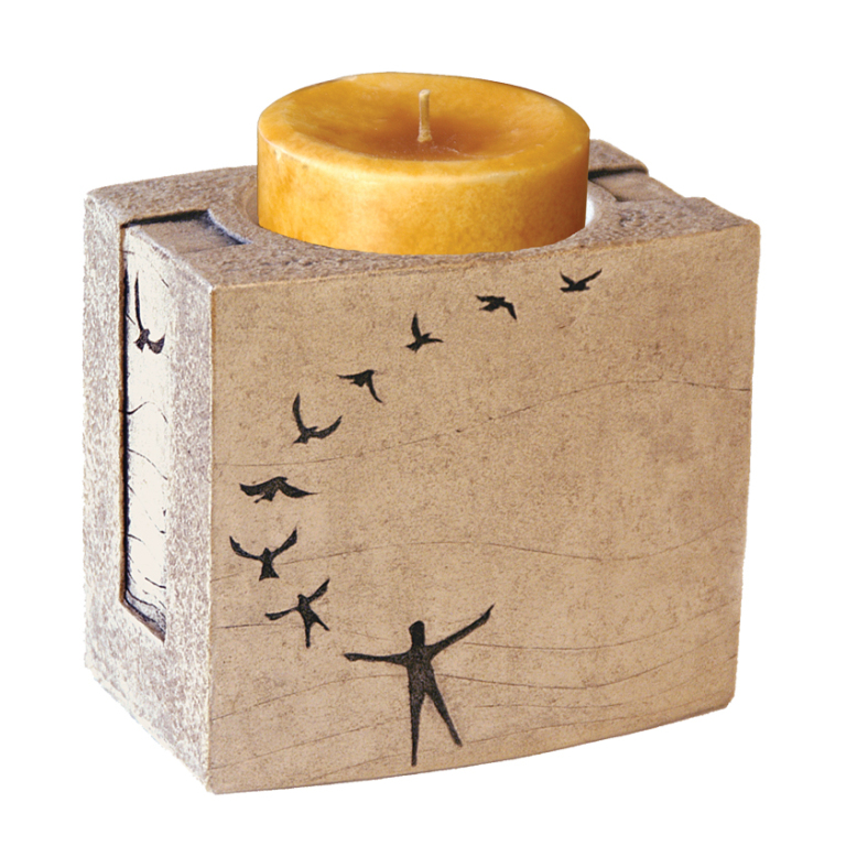 In Flight Textured Stone Candle Keepsake  133.00 5.5 W. x 5 H. x 3.75 D., 12 Cubic Inches