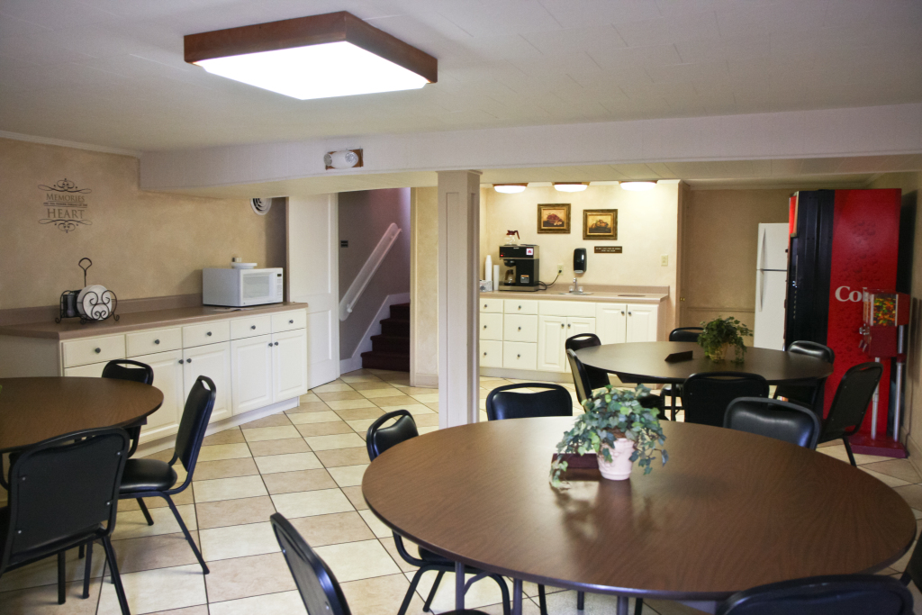 The lounge contains a full size refrigerator, microwave, and ample counter top space.