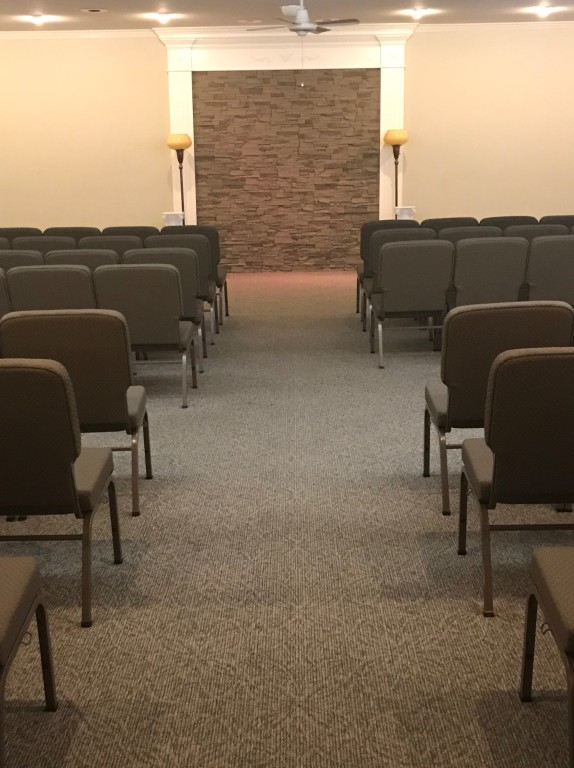 The main chapel features new carpet, fresh paint, and modular seating to meet the needs of any visitation.