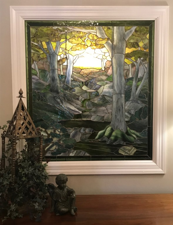 This custom art work graces the main hallway and was created specifically for the funeral home by local artists Kathy Zajac and Joe Larson of Home Studio glass.
