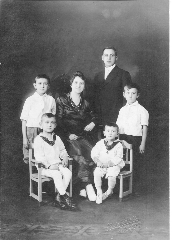 Top (left to right): Carl, wife Mary, Frank M., and son William Seated: sons Frank J. and George