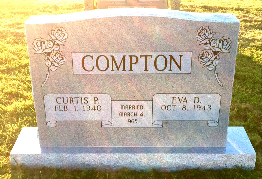 The Monument of Curtis P.  Eva D. Compton