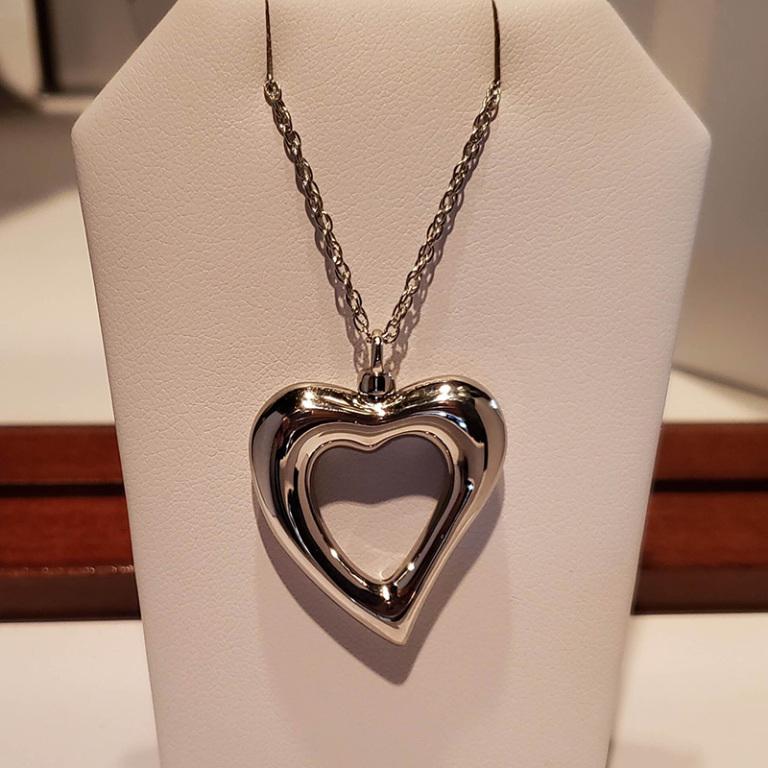 Silver open heart $130