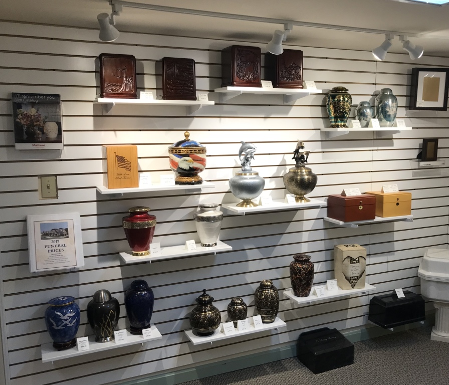 Large selection of cremation Urns and jewelry.