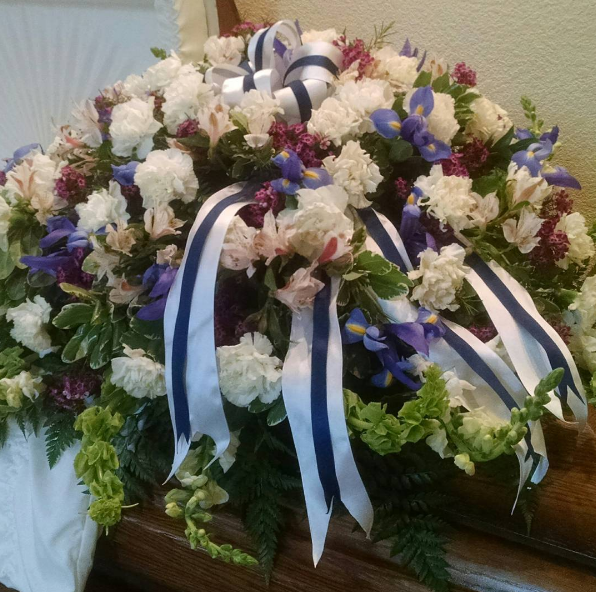 Purple and White casket Spray