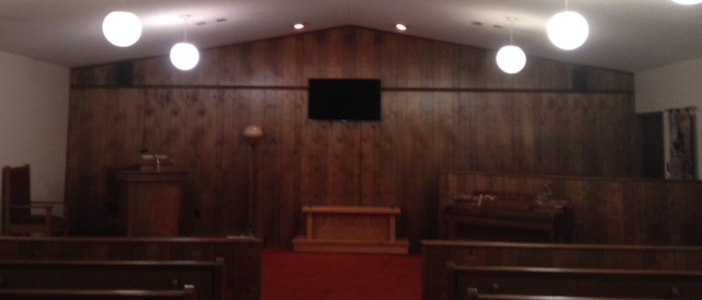 Flat screen TV in chapel for viewing of tribute videos