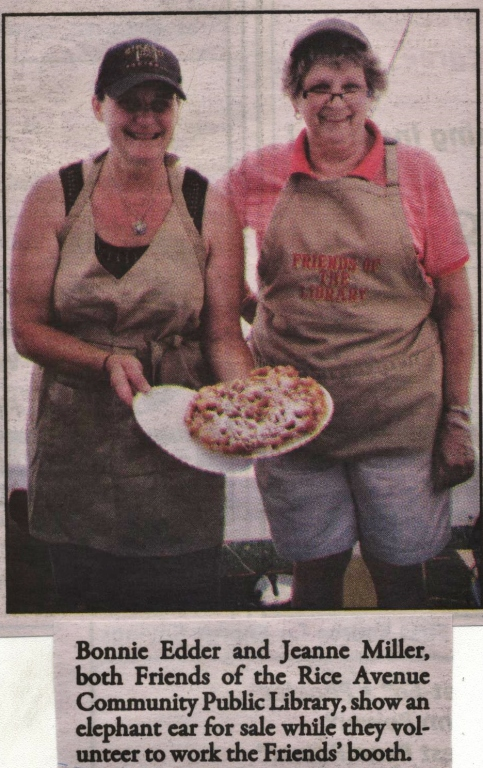 Bonnie Edder cooking funnel cakes to support the Rice Avenue Library at the Lake City Firemans Picnic