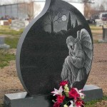 Weeping angel on a black granite teardrop