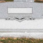 Granite companion marker with vases on each side