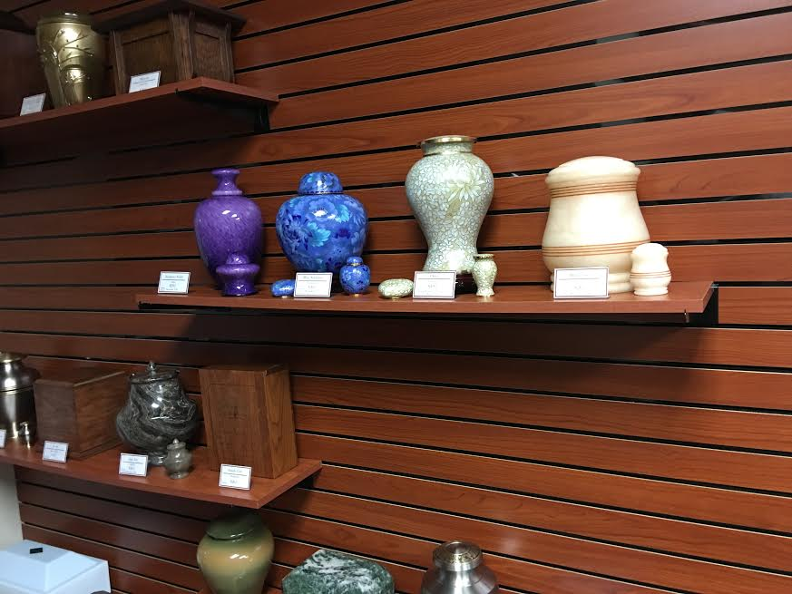 A small sample of the large variety of cremation, burial, and creative memorialization items offered.