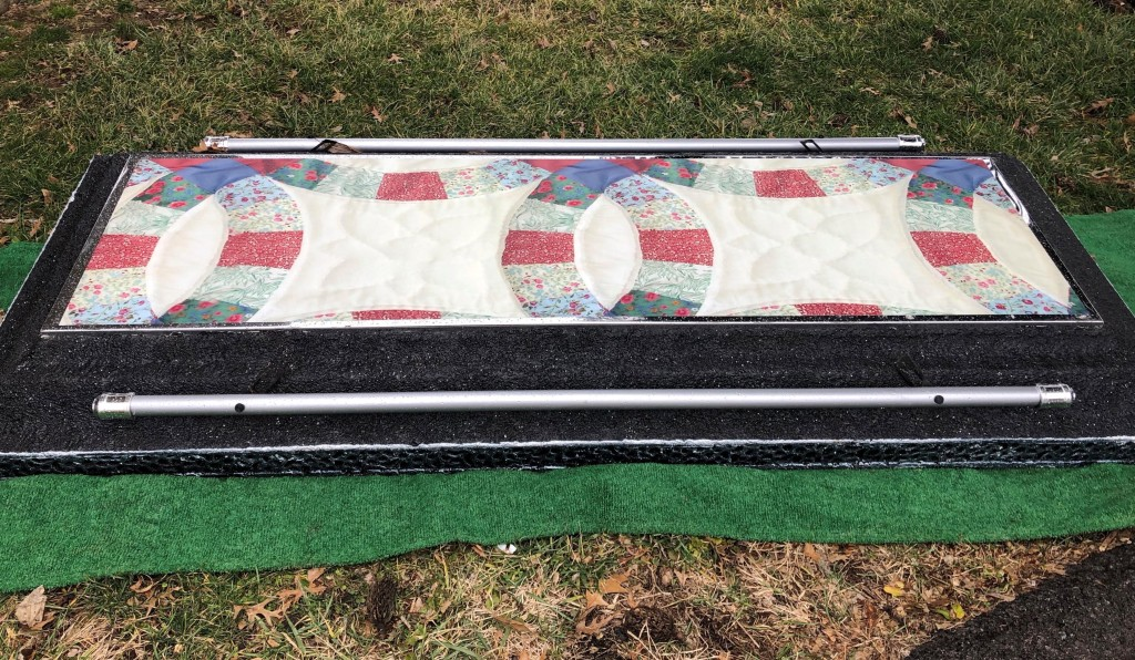 Unique vault lid for one who had a passion for quilting