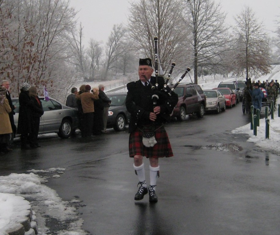 A bagpiper at Camp Nelson National Cemetery