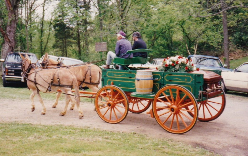 A mule team pulling a wagon to a family cemetery