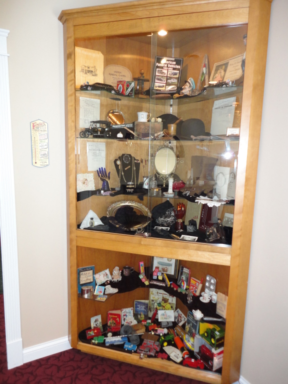 Our display case in the coffee lounge is fulled with interesting artifacts and items from over the years - everyone can relate to something in here.