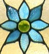 A feature from our stained glass window that inspired our exterior paint color