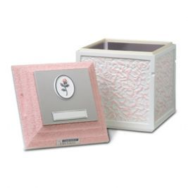 Cameo Rose Urn Vault  Durable concrete exterior. Cover and base lined with brushed stainless steel and high-impact ABS plastic. Plaque with delicate rose; nameplate for personalization.