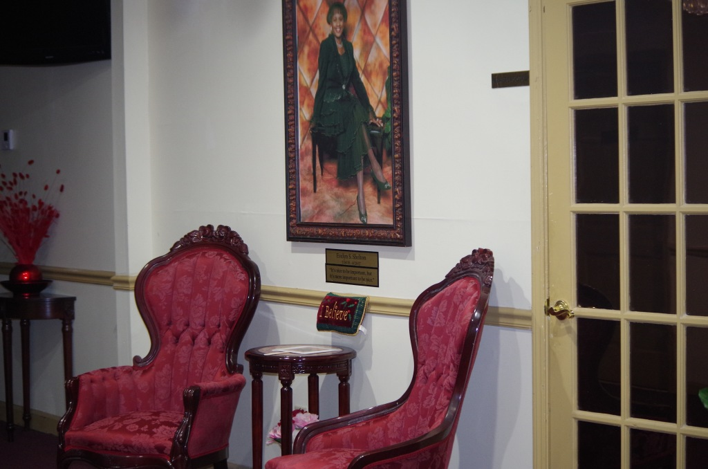 Another view of our foyer leading to the chapel with a beautiful photo of Mrs. Shelton.