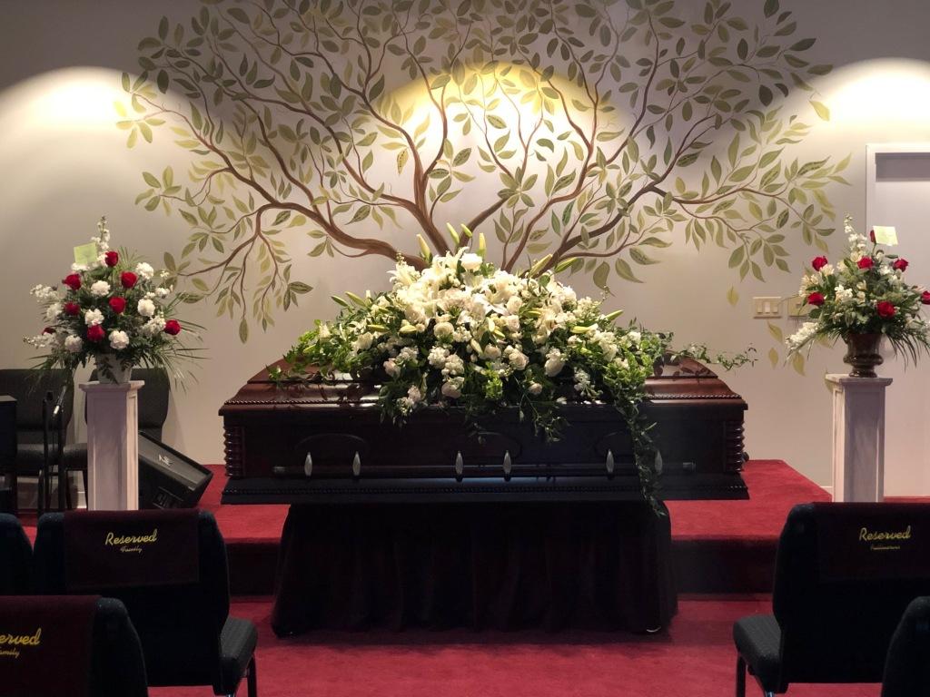 Tree of Life behind casket