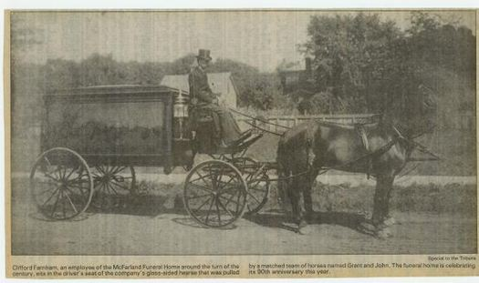 Horesdrawn hearse at the turn of the century