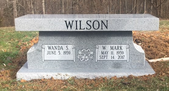 Front of headstone bench for Mark and Wanda Wilson