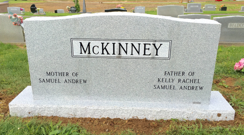 Back of McKinney triple headstone