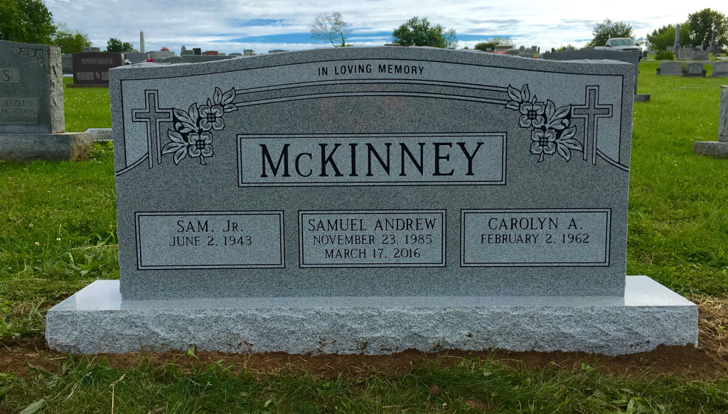 Front of McKinney triple headstone