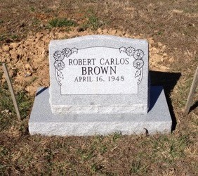 Robert Carlos Brown slant headstone with base