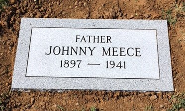 Flat granite marker for Johnny Meece