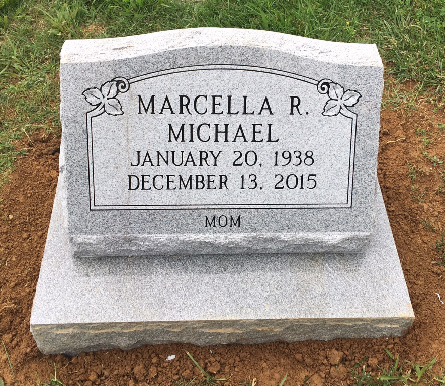 Granite slant marker and base for Marcella Michael