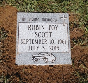 Flat granite marker for Robin Foy Scott