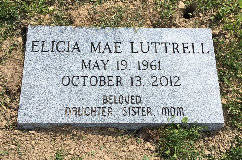 Flat granite marker for Elicia Luttrell