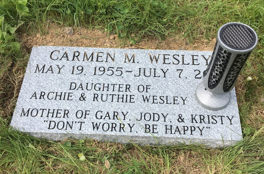 Flat granite marker for Carmen Wesley