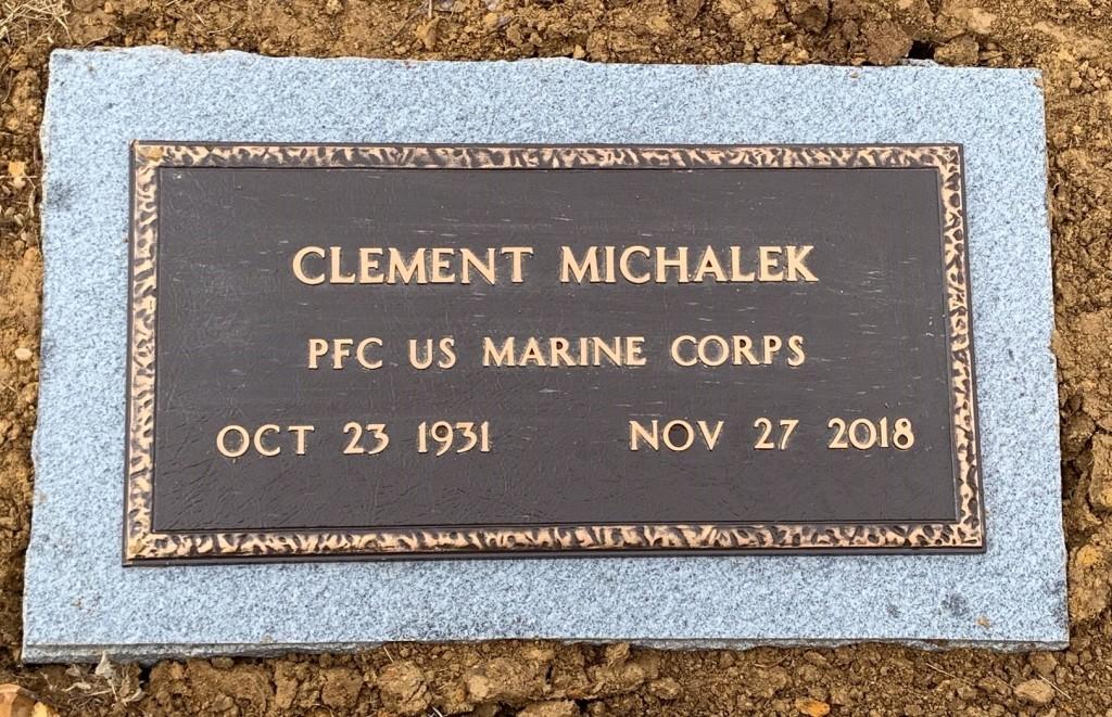 Veteran's bronze mounted to granite flat marker for Clement Michalek