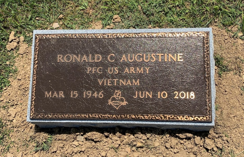 Veteran's bronze mounted to granite bevel for Ronald Augustine