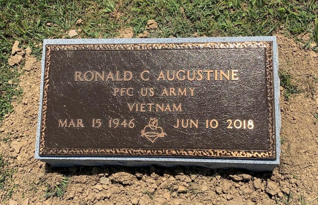 Veteran's bronze mounted to granite bevel for Ronald Augustine