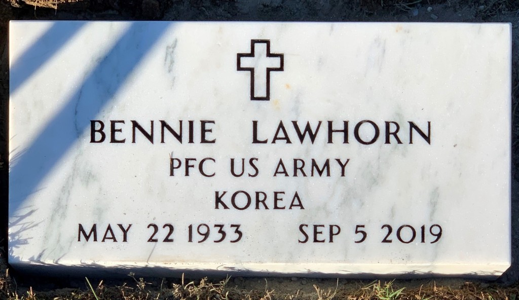 Veteran's white marble marker for Bennie Lawhorn
