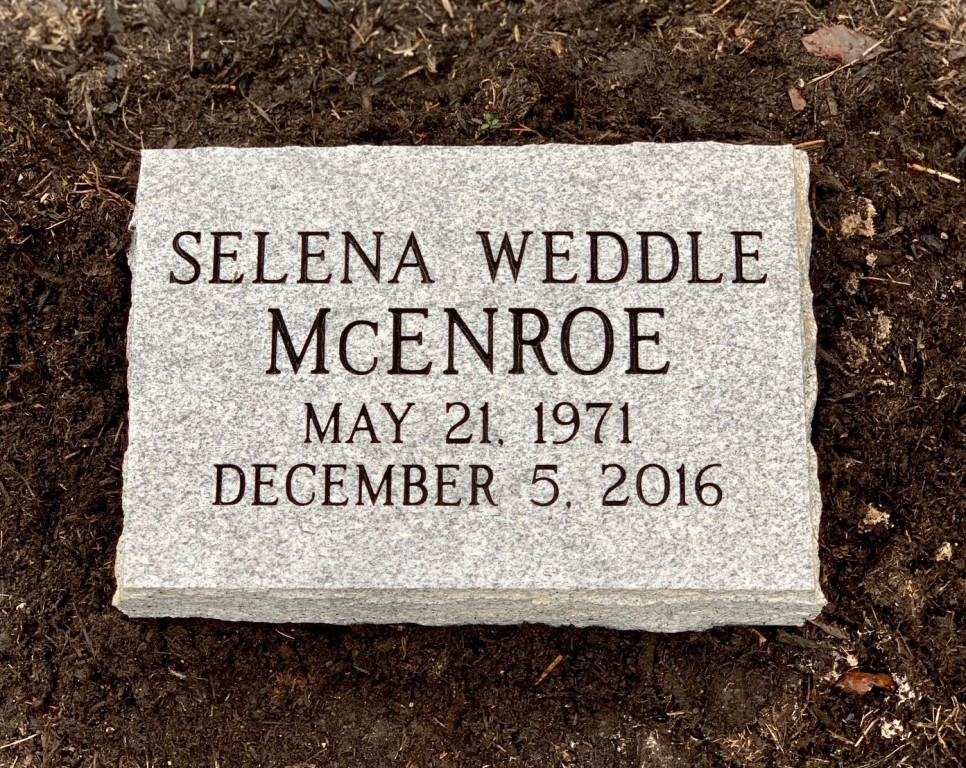 Flat granite marker for Selena Weddle McEnroe