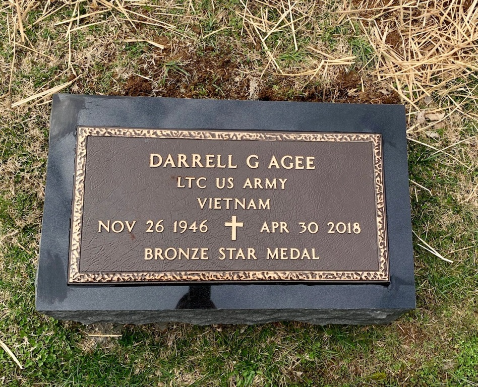 Veterans bronze marker for Darrell Agee mounted to black granite