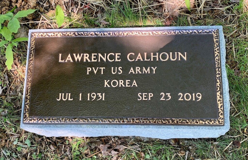 Veterans bronze marker for Lawrence Calhoun mounted to bevel base