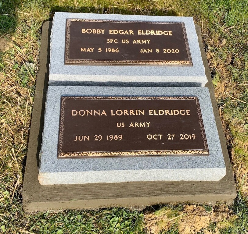 Bronze markers mounted to flat granite markers
