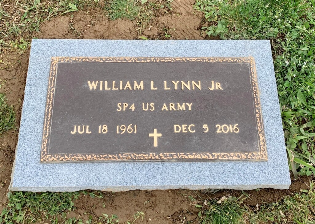 Bronze marker for William Lynn, Jr. mounted to flat granite