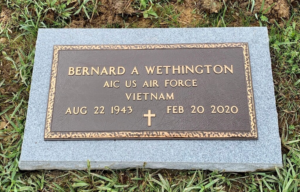 Bronze marker for Bernard Wethington mounted to flat granite
